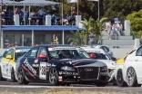 Simon Moss in the pack through turn one at Killarney