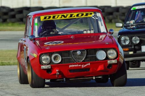 An Alfa Romeo races through the esses at Aldo Scribante Raceway.