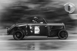 A classic car races up the hill in Knysna.