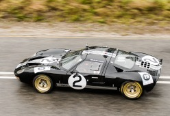 A Ford GT40 makes its way up the hill.