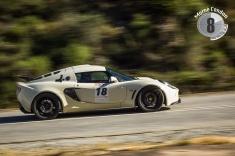 A Lotus races up the hill at Simola