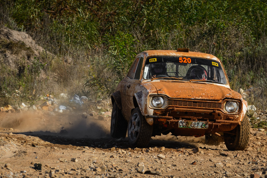 A Ford Escort rally car in action on gravel