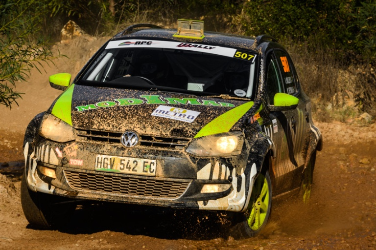 A Volkswagen Polo in action on gravel.