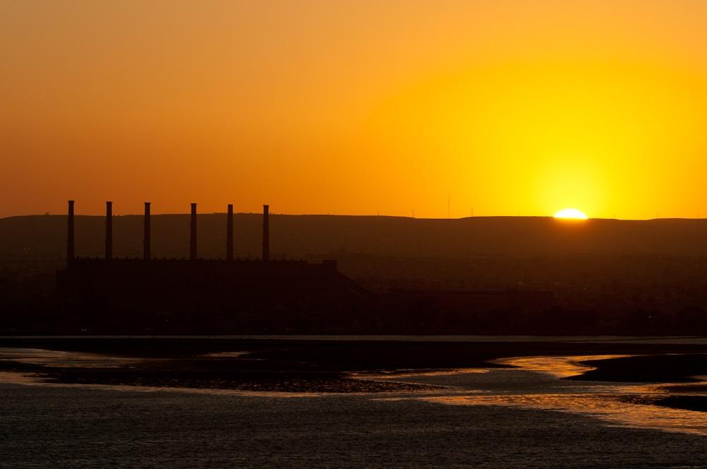 sunset near a power station